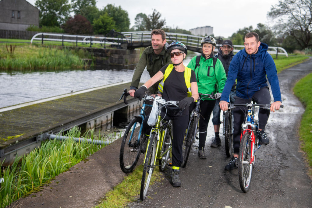 Photograph: Staff from Clydebank Housing Association and Centre81 join a led ride from Centre 81 alongside a canal